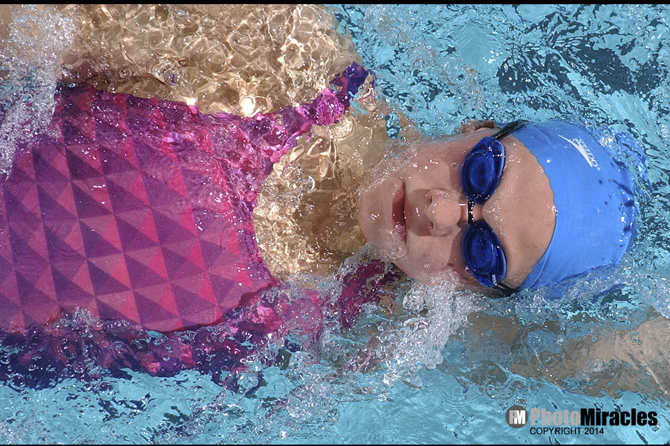A swimmer practices her backstroke at the US Olympics training facility in Colorado Springs, CO.