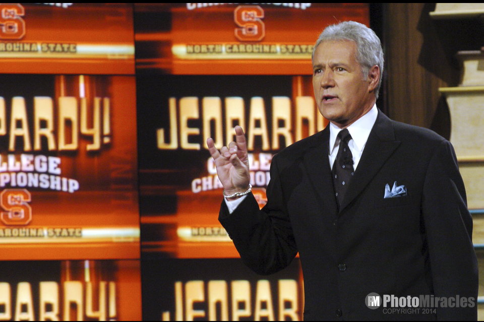 Alex Trebek greets the audience during the Jeopardy College Championships hosted by the NC State Wolfpack.