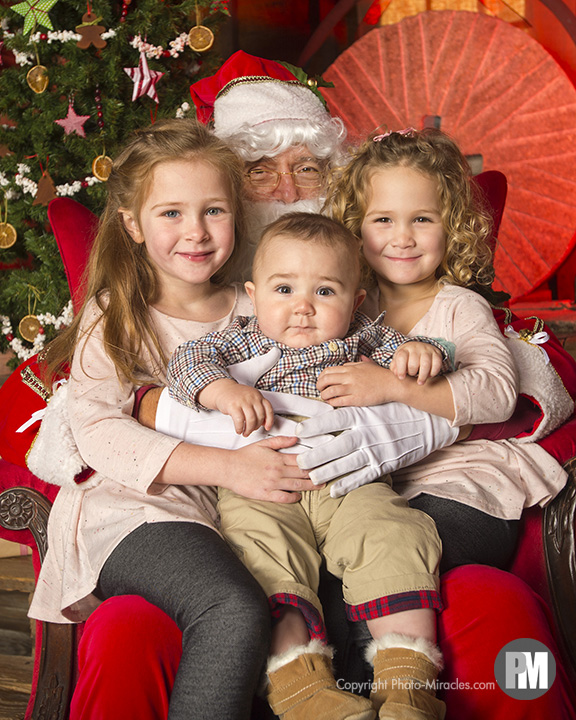 Santa sits for portraits at Yates Mill Historic Park.